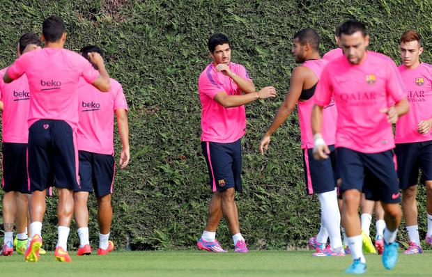 Barcelona's new player Luis Suarez (C) gestures during a training session at Ciutat esportiva Joan Gamper in Sant Joan Despi near Barcelona today