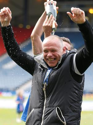 Inverness manager John Hughes led his team to their first national trophy after beating Falkirk to win the Scottish Cup
