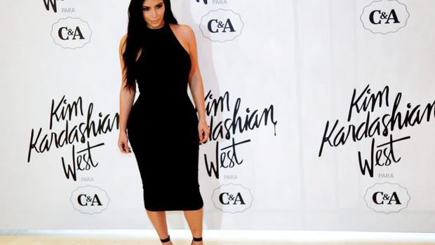 In Brazil in May, her black bodycon dress hugged every curve.