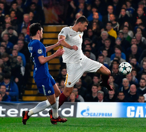Edin Dzeko, scoring for Roma at Stamford Bridge in the Champions League last year, has become Chelsea's main transfer target. Photo: Getty Images