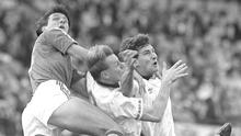 Great debate: Tony Cascarino equalises against England during Ireland's 1-1 draw in a Euro '92 qualifier at Lansdowne Road in November 1990 after beating Stuart Pearce and Terry Butcher to the ball. Photo: Sportsfile