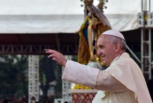 Pope Francis waves during his visit to Manila