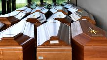 Stacking up: Coffins of people who have died from the virus in a crematorium in the Italian town of Serravalle Scrivia. Photo: REUTERS/Flavio Lo Scalzo