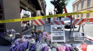 Flowers are laid at a memorial near the scene of a 4th-story apartment building balcony collapse in Berkeley, California June 16, 2015. Six people were killed, including five young Irish citizens, and at least seven other people were injured when an apartment balcony collapsed early on Tuesday in the Californian city of Berkeley, Ireland's foreign minister said