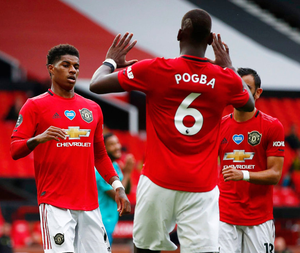 Manchester United's Marcus Rashford (left) celebrates scoring their second goal with Paul Pogba (c) and Bruno Fernandes at Old Trafford on Saturday