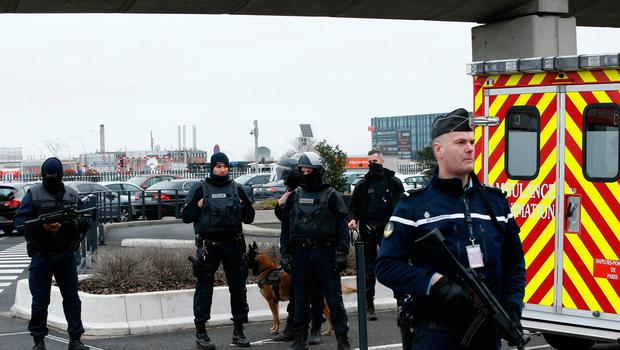 French police forces secure Orly airport, south of Paris, Saturday, March, 18, 2017. A man was shot to death Saturday after trying to seize the weapon of a soldier guarding Paris' Orly Airport, prompting a partial evacuation of the terminal, police said. Authorities warned visitors to avoid the area while an ongoing police operation was underway. (AP Photo/Thibault Camus)