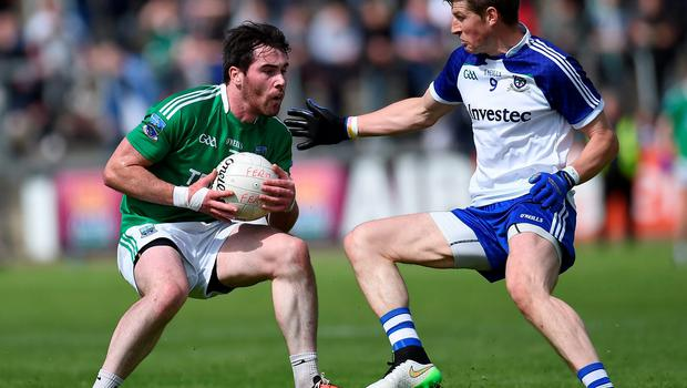 Fermanagh's Barry Mulrone does his best to lose Darren Hughes