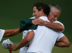 Adam Scott celebrates winning the Masters on the second playoff hole with caddie Steve Williams
