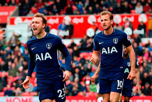 Tottenham Hotspur's Christian Eriksen celebrates scoring his side's first goal of the game with Harry Kane (right) during the Premier League match at the bet365 Stadium, Stoke. Saturday April 7, 2018. Nigel French/PA Wire.