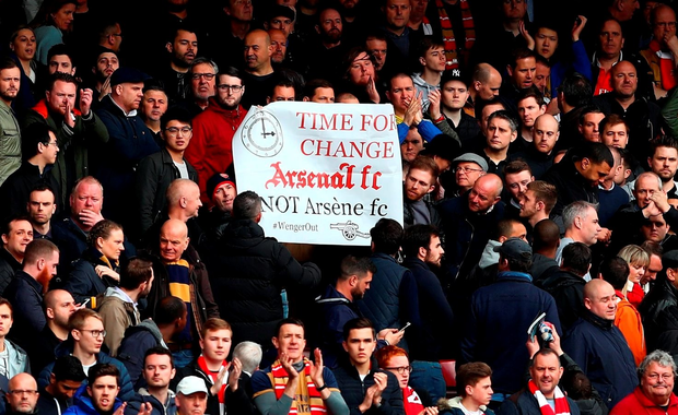 LONDON, UNITED KINGDOM - APRIL 09: A banner against Arsene Wenger Manager of Arsenal is displayed after the Barclays Premier League match between West Ham United and Arsenal at the Boleyn Ground on April 9, 2016 in London, England. (Photo by Clive Rose/Getty Images)