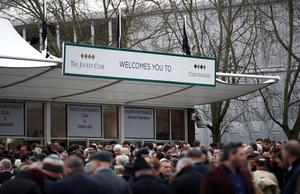 Crowd's wait for the gates to open on day one of the Cheltenham Festival at Cheltenham Racecourse, Cheltenham.