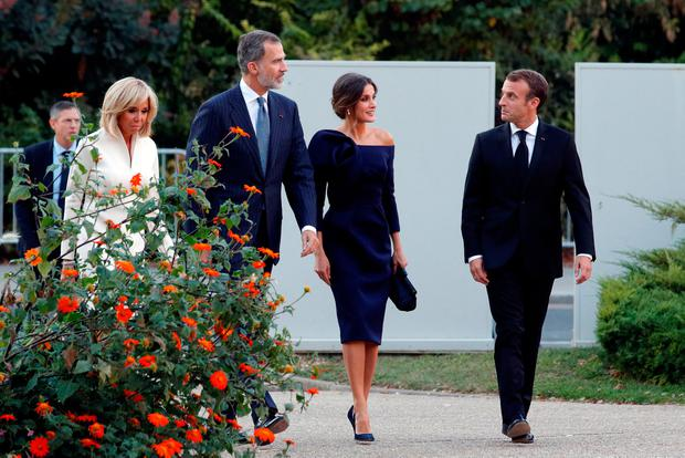 French President Emmanuel Macron, his wife Brigitte Macron, King Felipe VI of Spain and his wife Queen Letizia arrive to visit the retrospective of works by Spanish painter and sculptor Joan Miro (1893-1983) at Paris's Grand Palais, in Paris, France, October 5, 2018. REUTERS/Philippe Wojazer
