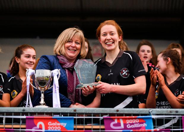 24 November 2019; Rena Buckley of Donoughmore receives the Player of the Match award from Marie Hickey, LGFA President, following the All-Ireland Ladies Junior Club Championship Final match between Donoughmore and MacHale Rovers at Duggan Park in Ballinasloe, Co Galway. Photo by Harry Murphy/Sportsfile