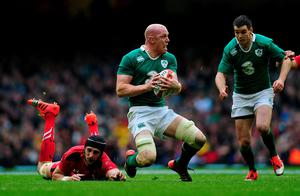 Paul O'Connell of Ireland is tackled by Luke Charteris of Wales