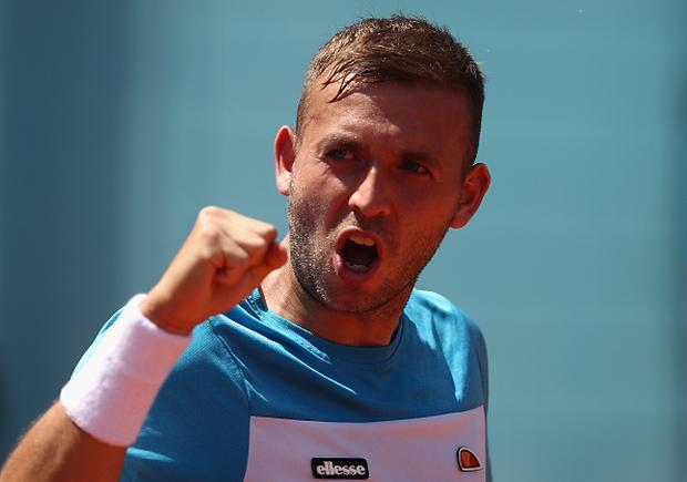 Dan Evans of Great Britain reacts in his match against Robin Haase of Netherlands during day three of the Mutua Madrid Open tennis at La Caja Magica on May 8, 2017 in Madrid, Spain. (Photo by Julian Finney/Getty Images)