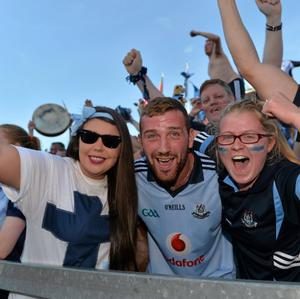 22 September 2013; Dublin supporters Danielle Halton, left, Anthony Brennan and Amy Brennan, from Portmarnock, celebrate their sides victory. GAA Football All-Ireland Championship Finals, Croke Park, Dublin. Picture credit: Barry Cregg / SPORTSFILE