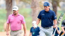 Graeme McDowell and Phil Mickelson play the 14th hole during Day 2 of the Saudi International. Photo: Ross Kinnaird/Getty Images