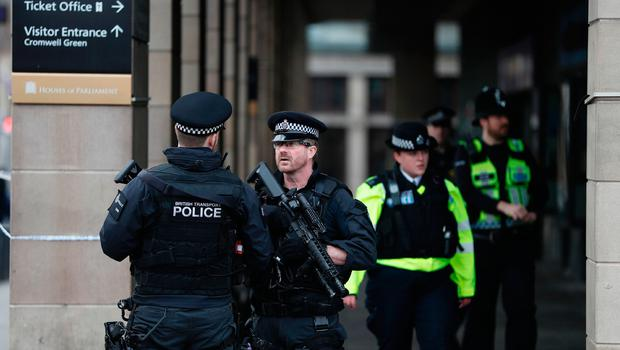 Armed police secure the area across the road from the Palace of Westminster after Westminster bridge reopened (Image: Getty Images)