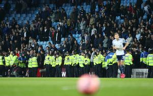Police line up infron of fans by the side of the pitch during the match Action Images via Reuters / Carl Recine