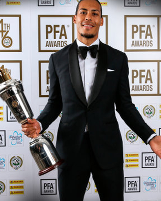 Liverpool's Virgil van Dijk poses with his PFA Player of the Year award