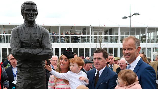 Jockey Tony McCoy, wife Chanelle and family Archie (3) and Eve (9) with sculptor Paul Ferriter with the parade ring statue Photo: Damien Eagers