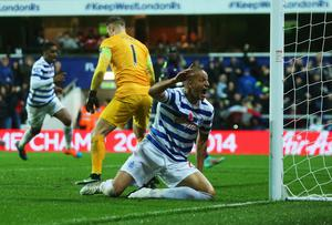 Bobby Zamora of QPR celebrates as Martin Demichelis of Manchester City (not pictured) scores an own goal for QPR's second goal. Photo credit: Scott Heavey/Getty Images