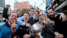 Dublin footballer Michael Darragh MacAuley and his girlfriend Rosie Cooney, with fans and the Sam Maguire Cup, celebrating the morning after their All-Ireland victory over Kerry. Boar's Head, Capel Street, Dublin. Picture: Caroline Quinn