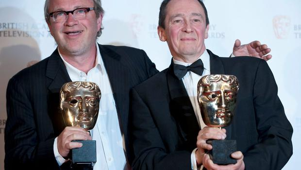 British actors Harry Enfield (L) and Paul Whitehouse (R) pose with their British Academy Television Award (BAFTA) for Comedy Programme Award for Harry and Paul in Central London on April 26, 2009.