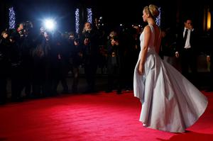 """"""" I knew the paparazzi were going to be a reality in my life,"""" the 24-year-old Oscar winner said. """"But I didn't know that I would feel anxiety every time I open my front door, or being chased by 10 men you don't know, or being surrounded, feels invasive and makes me feel scared and gets my adrenaline going every day"""" (REUTERS/Luke MacGregor)"""