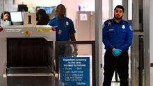 Uncertain times: Transport security admin officers on duty at the departure area of the Los Angeles International Airport. Photo: Getty