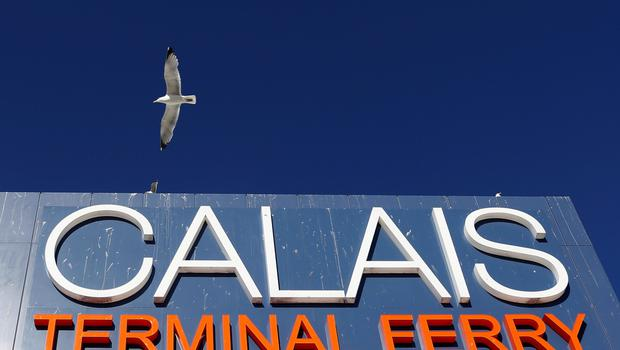 A seagull flies over a sign at the harbour of Calais, northern   REUTERS/Vincent Kessler