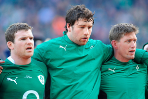 McLaughlin standing for the national anthem with Ireland team-mates Gordon D'Arcy and Ronan O'Gara at Croke Park in 2010. Photo: Brendan Moran / Sportsfile