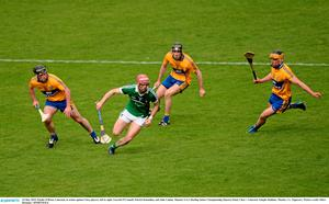 24 May 2015; Paudie O'Brien, Limerick, in action against Clare players, left to right, Gearid O'Connell, Patrick Donnellan, and John Conlon. Munster GAA Hurling Senior Championship Quarter-Final, Clare v Limerick. Semple Stadium, Thurles, Co. Tipperary. Picture credit: Dire Brennan / SPORTSFILE