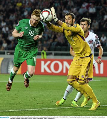 7 September 2014; Stephen Quinn, Republic of Ireland, in action against Giorgi Loria, Georgia. UEFA EURO 2016 Championship Qualifer, Group D, Georgia v Republic of Ireland. Boris Paichadze National Arena, Tbilisi, Georgia. Picture credit: David Maher / SPORTSFILE