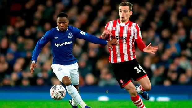 Everton's Ademola Lookman and Lincoln City's Harry Toffolo battle for possession yesterday. Photo: Nick Potts/PA Wire
