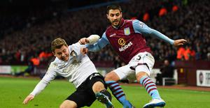 Carles Gil of Aston Villa is tackled by Ryan Fraser of Bournemouth
