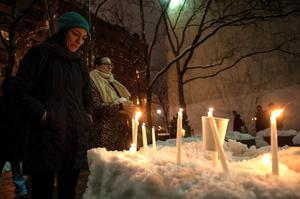 NEW YORK, NY - FEBRUARY 05:  People gather to pay their respects during the Candlelight Vigil For Philip Seymour Hoffman at the Labyrinth Theater Company on February 5, 2014 in New York City.  (Photo by D Dipasupil/Getty Images)