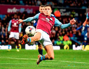 Jack Grealish stretches for the ball in the air during the Capital One Cup clash at Villa Park