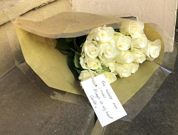 A bouquet of white roses outside the former residence of Dale Winton (Jamie Johnson/PA)