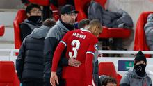 Liverpool's Fabinho with manager Juergen Klopp after being substituted after sustaining an injury. Picture:Pool via REUTERS/Phil Noble