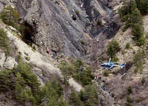 A French gendarme helicopter flies over the moutainside crash site of an Airbus A320, near Seyne-les-Alpes, March 25, 2015.  REUTERS/Emmanuel Foudrot