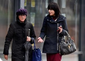 Teaching assistant Helen Turnbull (right) arriving at Teesside Crown Court in Middlesbrough, with an unidentified woman, where she has pleaded guilty to one count of sexual activity with a child by a person in a position of trust, but denies three other counts Owen Humphreys/PA Wire