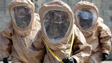 Soldiers of the US Army 23rd chemical battalion put on their gear as they give a demonstration of their equipment during a ceremony to give notice of the battalion's official return to the 2nd Infantry Division based in South Korea