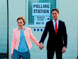 Labour Party leader Ed Miliband and his wife Justine after casting their votes at Sutton village hall in Doncaster. Photo: PA