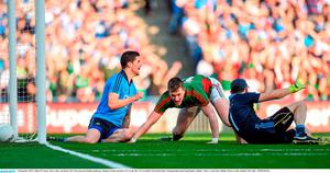 5 September 2015; Cillian O'Connor, Mayo, after scoring his side's first goal past Dublin goalkeeper Stephen Cluxton and Rory O'Carroll, left. GAA Football All-Ireland Senior Championship Semi-Final Replay, Dublin v Mayo. Croke Park, Dublin. Picture credit: Stephen McCarthy / SPORTSFILE