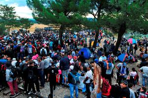 Migrants wait to cross the Greek-Macedonian border near the town of Idomeni, northern Greece on August 21, 2015. At least five migrants were slightly hurt August 21 when Macedonian police threw noise grenades to drive back refugees from the country's border with Greece, an AFP photographer at the scene said. More than 3,000 mostly Syrian refugees are stuck in no-man's land near the Greek village of Eidomeni after Macedonia August 20 declared a state of emergency and sent troops to help stem the flow of migrants attempting to cross the Balkan country to reach northern Europe. AFP PHOTO / SAKIS MITROLIDISSAKIS MITROLIDIS/AFP/Getty Images