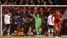 Liverpool's Adam Lallana (second left) lies dejected on the pitch after a missed chance on goal during the FA Cup Fourth Round match at Anfield, Liverpool.