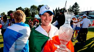 Leona Maguire of Team Europe celebrates with the Solheim Cup at the Inverness Club in Toledo, Ohio, USA. Photo by Brian Spurlock/Sportsfile
