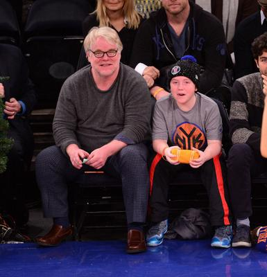 Phillip Seymour Hoffman and Cooper Alexander Hoffman attend the Oklahoma City Thunder vs New York Knicks game at Madison Square Garden on December 25, 2013 in New York City.  (Photo by James Devaney/WireImage)