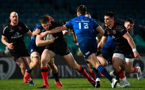 Stuart McCloskey of Ulster is tackled by Josh van der Flier and Ross Byrne of Leinster during the Guinness PRO14 match at the RDS Arena in Dublin. Photo by Brendan Moran/Sportsfile